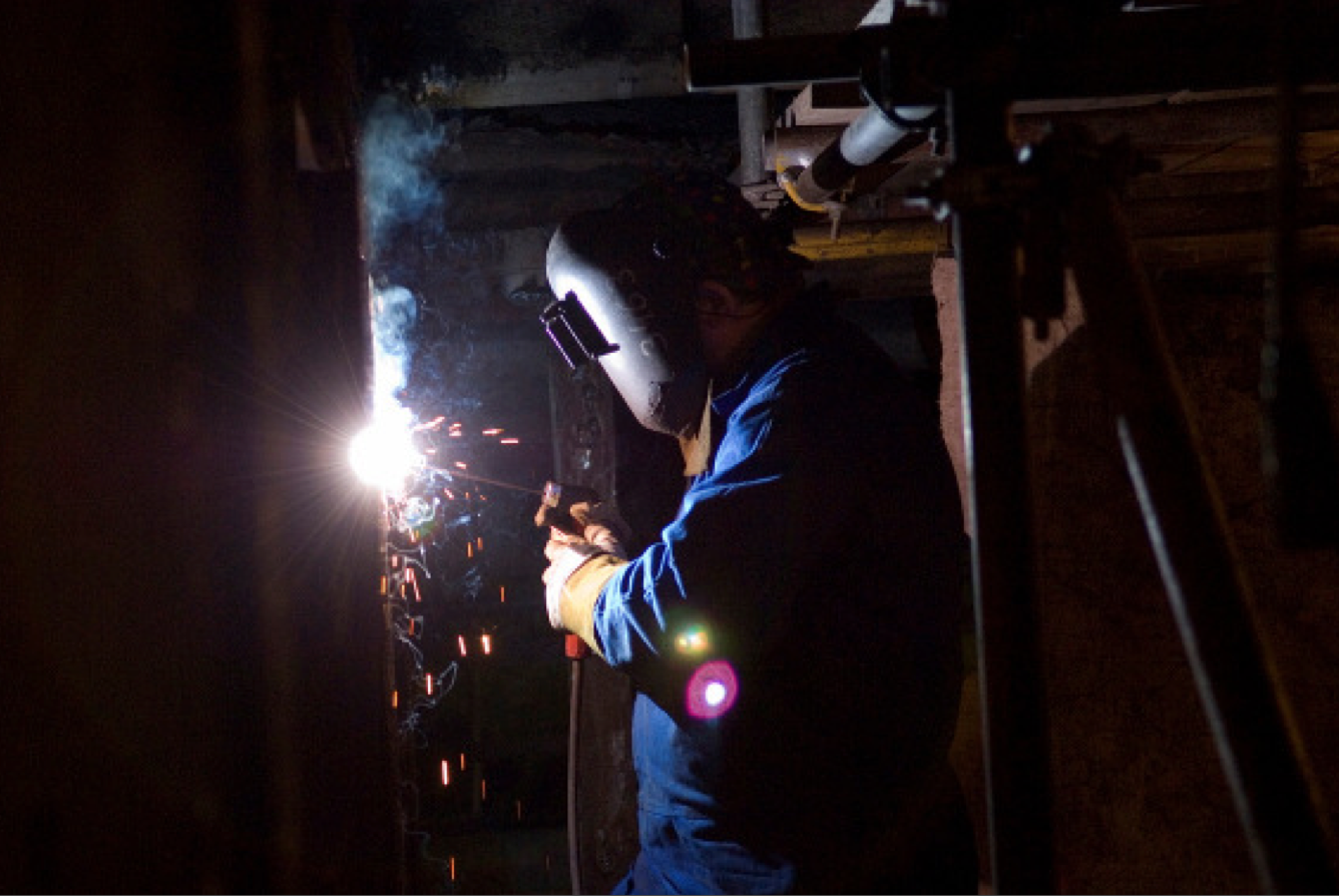 Polish welder supplied by Central European Staffing at work Cockenzie Power Station, East Lothian, Scotland, 2008